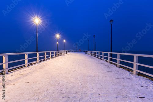 Foto op Plexiglas Donkerblauw Snowy pier at Baltic Sea in Gdansk, Poland