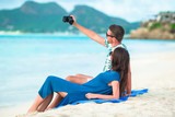Happy couple taking a selfie photo on white beach. Two adults enjoying their vacation on tropical exotic beach - 194885829