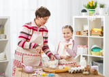 Mother and daughter cook at home. Making cookies, kitchen interior, healthy food concept - 194889254