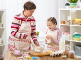 Mother and daughter cook at home. Healthy food concept - 194889271