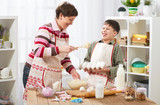 Mother and son cook at home. Healthy food concept - 194889403