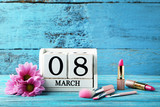 Wooden cube calendar with makeup cosmetics and flowers - 194891281