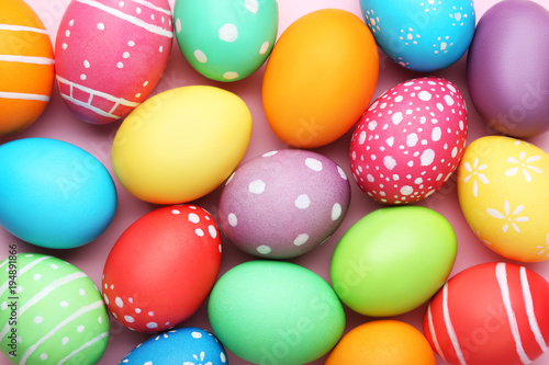 Colorful easter eggs on pink background