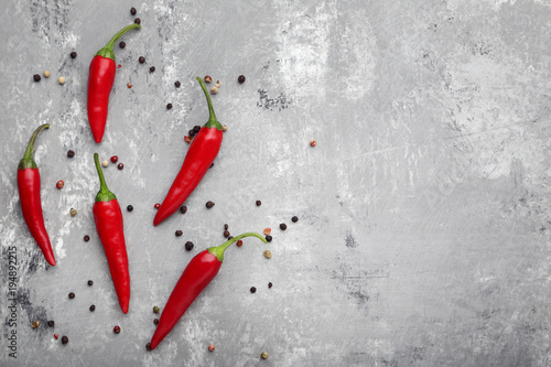 Red chili pepper on grey wooden table