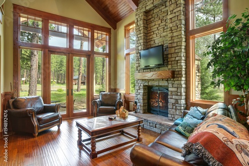 Wall mural Stunning living room design with a stone wall fireplace