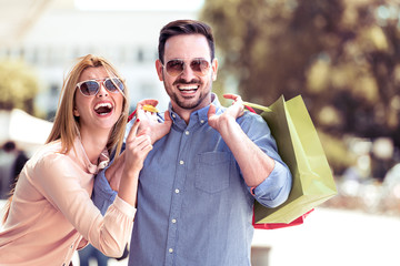 Happy couple in shopping.