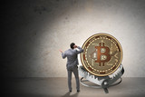Businessman falling into the trap of bitcoin cryptocurrency - 194900008