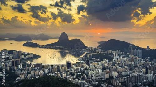 In de dag Rio de Janeiro Sunrise over Sugarloaf Mountain in Rio de Janeiro, Brazil. High angle view with reflection of the rising sun on water