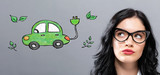 Electric Vehicle with young businesswoman in a thoughtful face