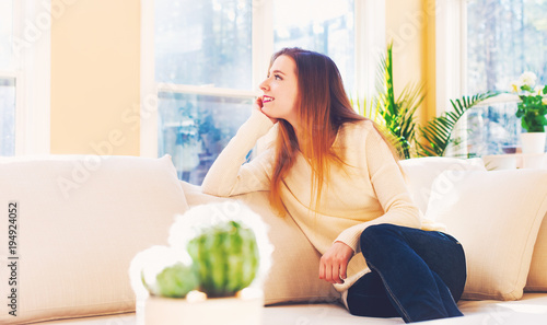 Young woman relaxing on a couch at home