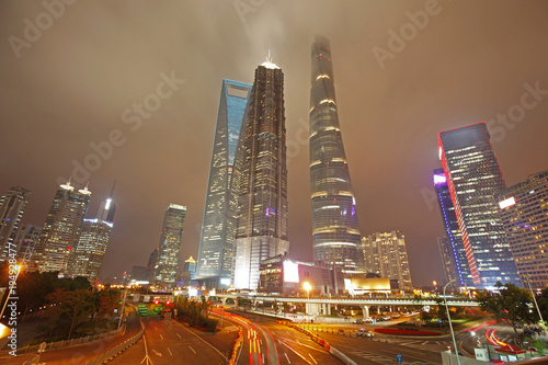 Fotobehang Abstractie the light trails on the modern building background in shanghai china
