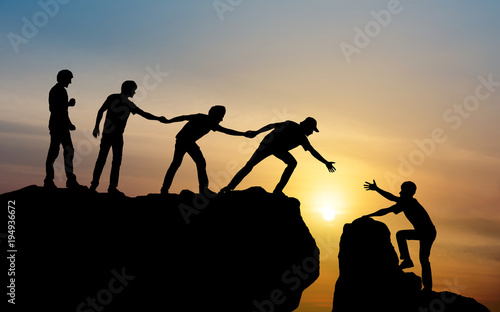 Leinwandbild Motiv Group of people on peak mountain climbing helping team work , travel trekking success business concept