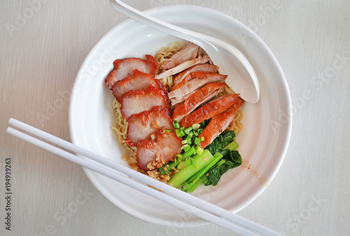 Foto op Canvas Peking Top view Egg noodle with roasted duck and pork, Chinese food.