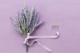 Lavender flower on purple wooden background. - 194944474