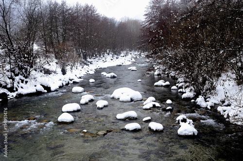 Fotobehang Bergrivier the Gardon snowy river in the French region of Cevennes
