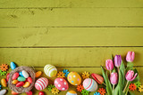 Colorful Easter border on green wood