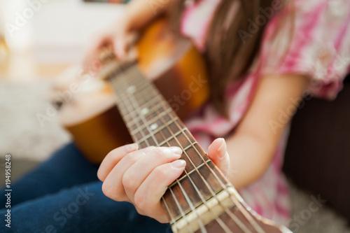 Fototapeta Music woman play acoustic guitar