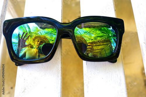 Sun glasses lying on a deckchair
