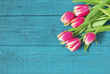 Beautiful fresh tulips on wooden background