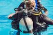 grey scuba diving air oxygen tank on the back of a scuba diver