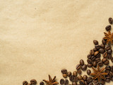 Coffee on paper background with coffee beans and star anise, copy space, top view. - 194973226