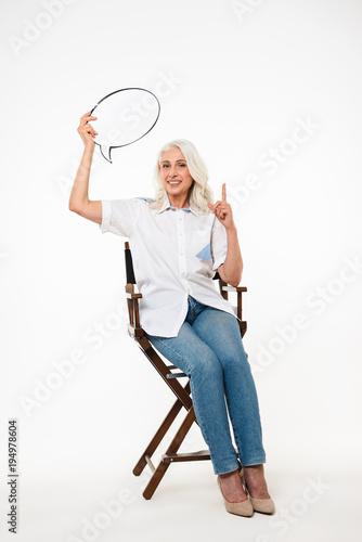 Full length portrait of a happy mature woman