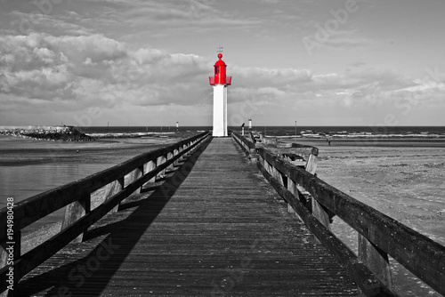 Fotobehang Vuurtoren Trouville lighthouse, red selective color, Normandy, France