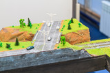 Train hobby model with railways, trees, grass and stations - 194981414