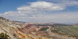 Capitol reef, central Utah, USA. Panoramic overview to valley and mountains with beautiful lens clouds in blue sky.