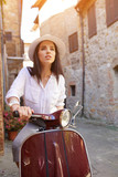 Young beautiful woman sitting on a italian scooter. - 194993459