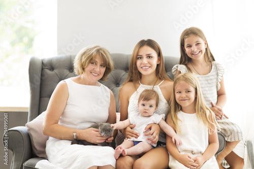 Staande foto Wanddecoratie met eigen foto Grandmother and granddaughters.