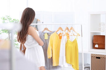 Young beautiful woman shopping in store