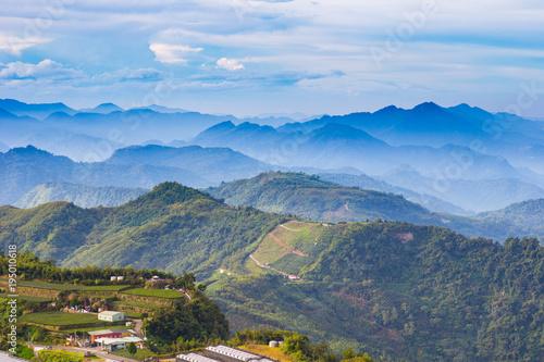 Fotobehang Blauwe hemel Mountains, tea gardens and fog in Taiwan.