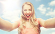 happy smiling young woman taking selfie