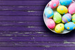 close up of colored easter eggs on plate - 195022649