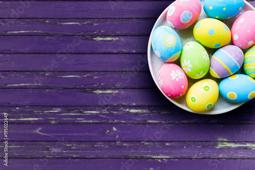 Wall mural close up of colored easter eggs on plate