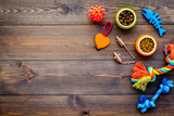 Pet care concept. Toys near bowls with animal feed on dark wooden background top view copy space - 195024674