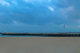 Wood pier with lighthouse for ships in Ostend, Belgium - 195025064