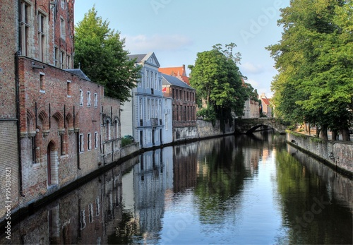 Fotobehang Brugge Canal bridge and medieval houses along the canal at Gouden-Handrei, Bruges, Belgium