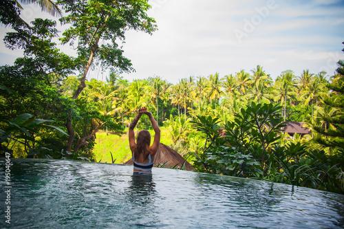 Staande foto Bali young girl resting in beautiful island jungle