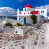 Traditional church with red dome and whitewashed facade, typical Greek church building on the island Mykonos, The island of the winds, Greece - 195047444