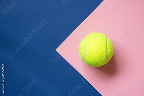 Deurstickers Bol Tennis ball on blue and pink paper background. Concept sport. Copy space