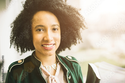 Lovely friendly brazil latin girl looking to the camera. Cool sunny portrait