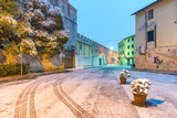 PISA, ITALY - MARCH 1, 2018: Street of Pisa with snow on a winter morning. Last snowfall had been in 2010