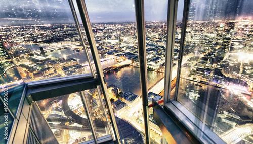 City night skyline through window glasses - 195058682