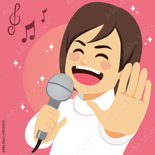 Fototapeta Happy young man singing song passionately with microphone