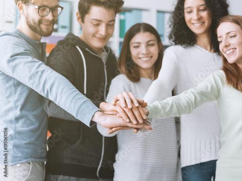 Foto op Aluminium Hoogte schaal Young people stacking hands