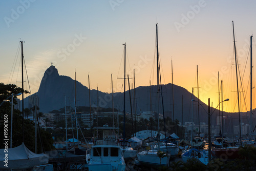 Keuken foto achterwand Rio de Janeiro View of Christ the Redeemer at dusk with sailboat masts.