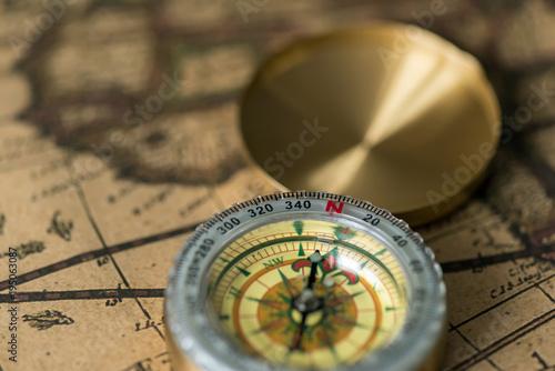 Fototapeta Old compass on vintage map
