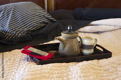 Foto op Canvas Zen Authentic leisure in bed with electronic reader and tea